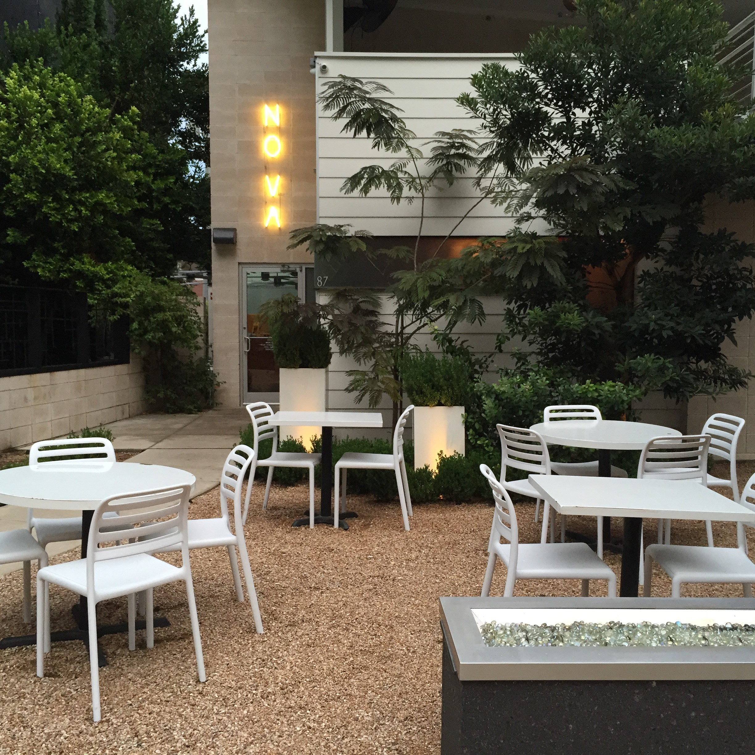 Updates resin chairs at atx restaurant for Hotel design blog